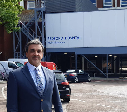 Picture of Mr Dan Arvinte in front of Bedford Hospital.